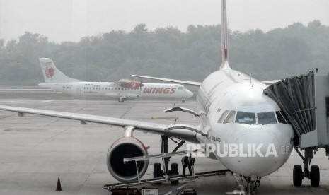 Kabut Asap Sulitkan Tiga Maskapai Mendarat di Pekanbaru.