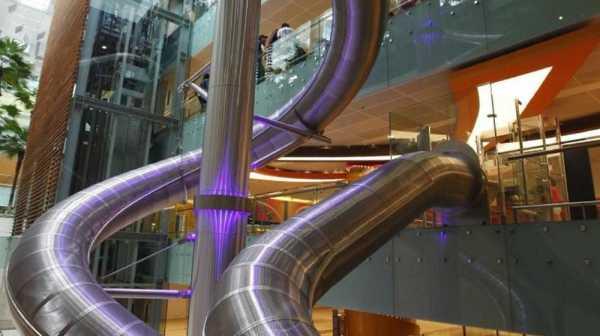 Bandara Changi Punya Seluncuran Menuju Pintu Penerbangan