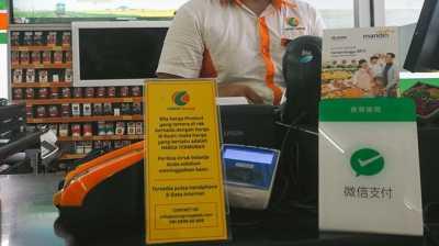 Transaksi Turis Cina di Bali: WeChat Pay Untung, Bali Buntung